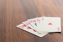 Playing cards - poker hand royal flush hearts Stock Image