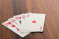 Playing cards - poker hand royal flush hearts Stock Images