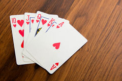 Playing cards - poker hand royal flush hearts Royalty Free Stock Photos