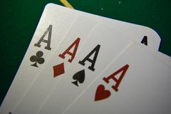 Playing cards on a poker table. four of a kind stock photo