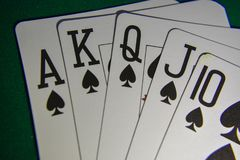 Playing cards on a poker table royal flush. stock image