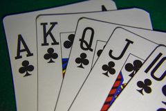 Playing cards on a poker table royal flush. royalty free stock photography