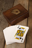 Playing cards in a presentation box. Playing cards in a wooden presentation box Stock Image