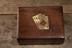 Playing cards in a presentation box. Playing cards in a wooden presentation box Stock Photo