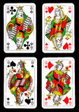 Playing cards - queens. Playing cards representing four queens on black background Royalty Free Stock Photography