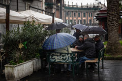 Playing cards in the rain, Naples, Italy. Stock Photos