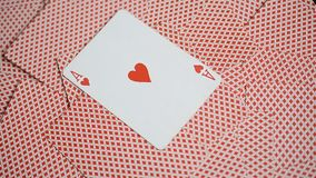 Playing cards red background and ace of hearts. Rotated stock video