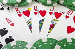 Playing cards (royal flush) and casino chips Royalty Free Stock Photography