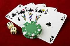Playing cards (Royal flush), casino chips and dices Royalty Free Stock Photography