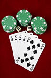 Playing cards (Royal flush), casino chips and dices Stock Photography