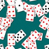 Playing cards scattered on a green table. Seamless pattern texture background Royalty Free Stock Photo