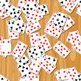 Playing cards seamless pattern texture background. Playing cards on the woody table seamless pattern texture background Royalty Free Stock Photography