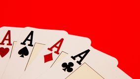 Playing cards showing a four ACEs, game time royalty free stock photo