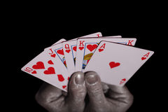 Playing cards in the silver hands Royalty Free Stock Photos