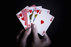 Playing cards in the silver male Royalty Free Stock Photo