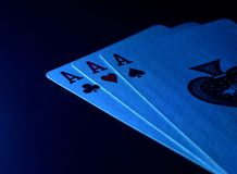Playing Cards Spade Hearts Clubs with Dark Background Photograph. Beautiful playing cards including lead cards of clubs, hearts and spades with dark background Royalty Free Stock Photography