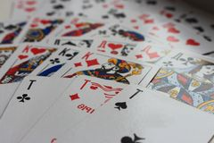 Playing cards spread out in fan as gambling and luck concept background. Stock Image