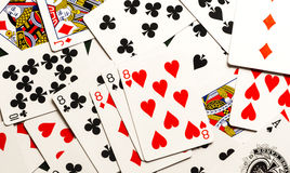 Playing cards spread out and mixed together. stock images