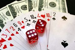 Playing cards stacked in a pile of dice royalty free stock photography