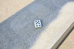 Playing cards in the street stock image