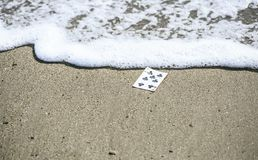 Playing cards in the street royalty free stock photo