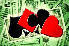 Playing cards suits and money Stock Images