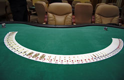 Playing cards on a table. Spraded playing cards on a green table Royalty Free Stock Photo