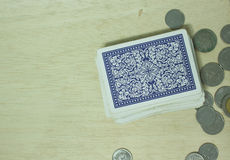 Playing cards on table casino. Handle the cards on the table royalty free illustration