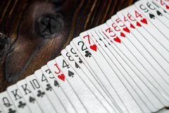 Playing cards on the table stock photos