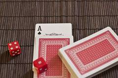 Playing cards on the Table with Dices. Ace of Spades on the Table Stock Photography