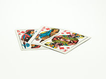 Playing cards. On a table isolated stock image