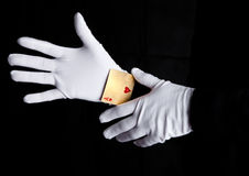 Playing cards trick with ace hands with gloves stock image