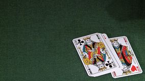 Playing Cards, Two Aces and Three Kings falling on Green Baize. Slow Motion stock footage