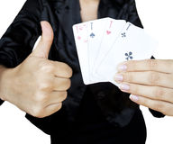Playing cards in woman�s hands Royalty Free Stock Photography