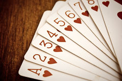 Playing cards. On wooden background, for valentines day stock images