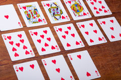 Playing cards on wooden background Stock Images
