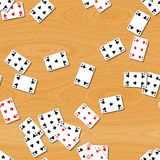 Playing cards on wooden table seamless background Stock Photo