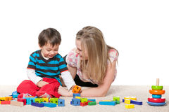 Playing on the carpet mother and a little son Stock Image