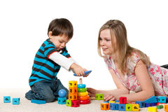 Playing on the carpet mother and son Royalty Free Stock Photography