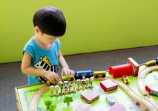 Playing cars and traffic sign toys stock photos