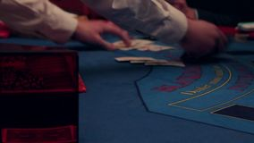 Playing a casino on the table, distribution of cards stock video footage
