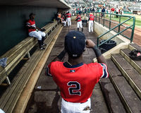 Playing catch in the dugout Royalty Free Stock Image