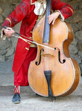 Playing cello. A man playing a cello Royalty Free Stock Images