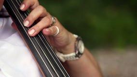 Playing the cello closeup stock video