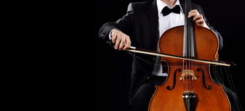 Playing cello. Holding hands cello on black background stock image