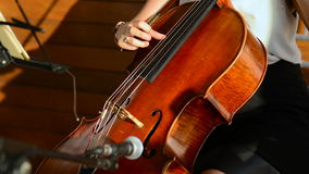 Playing the cello stock video footage