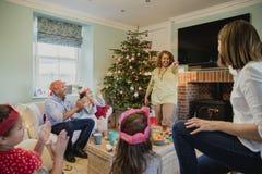 Playing Charades At Christmas Stock Images