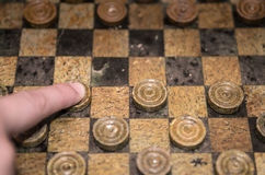 Playing checkers game. Finger moving one piece stock photos
