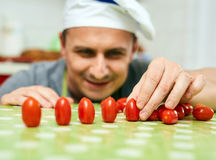 Playing with cherry tomatoes Royalty Free Stock Photos