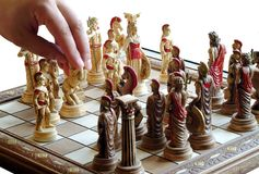 Playing chess. Special carved items,art pieces,hand making a move,isolated Stock Photo